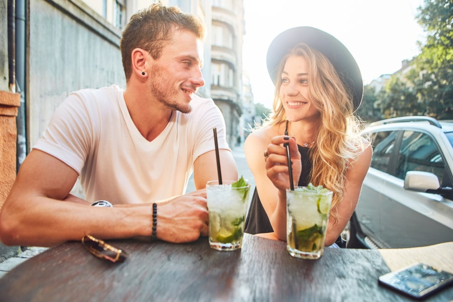 Man and woman at having a drink